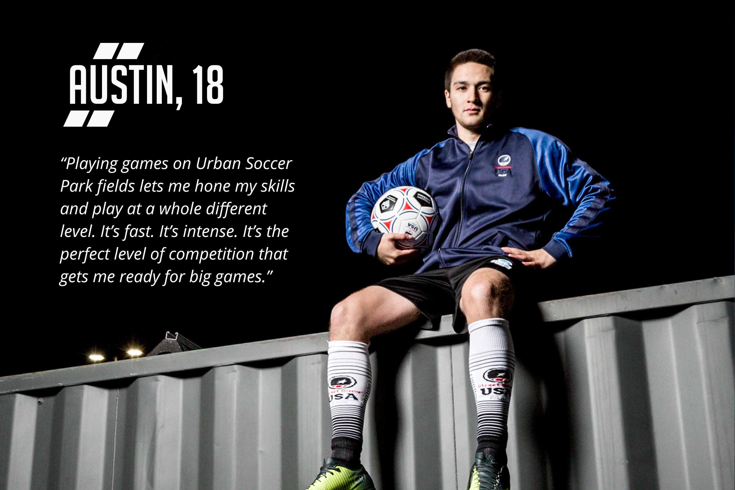 Soccer player sitting on top of a shipping container at night.