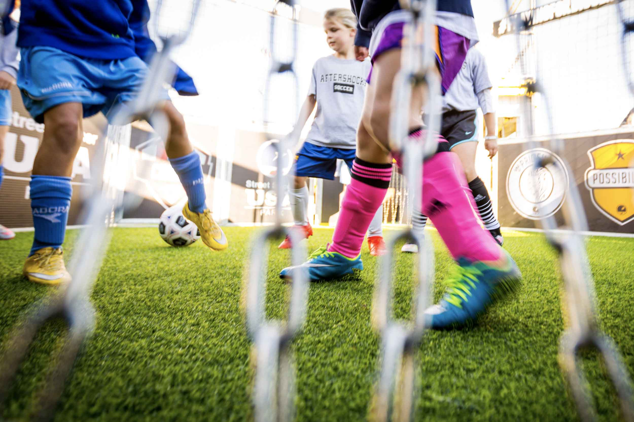 Kids playing small-sided soccer with chain goal at Urban Soccer Park.