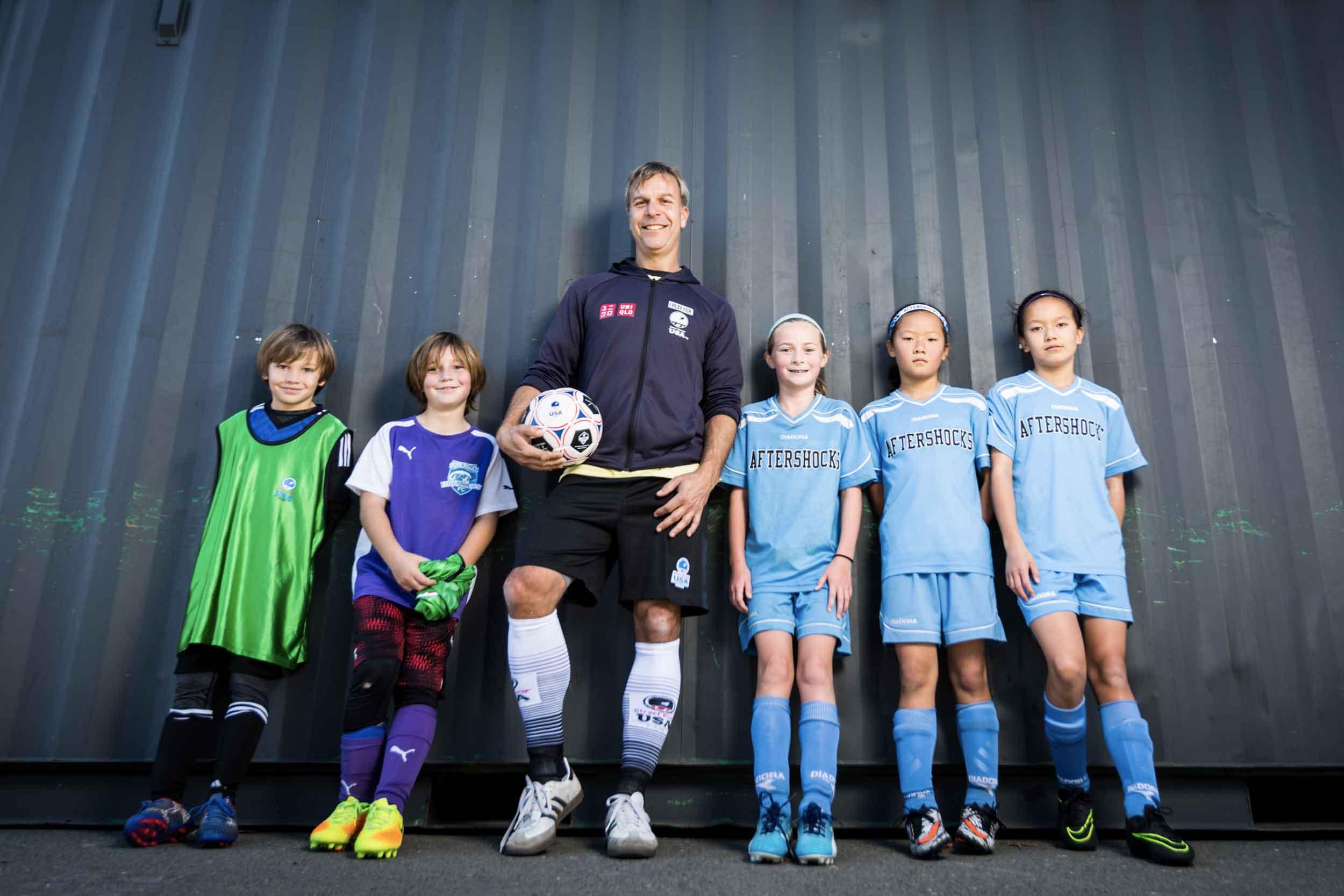 Urban Soccer Park found, Josh Frazier, with kid soccer players.