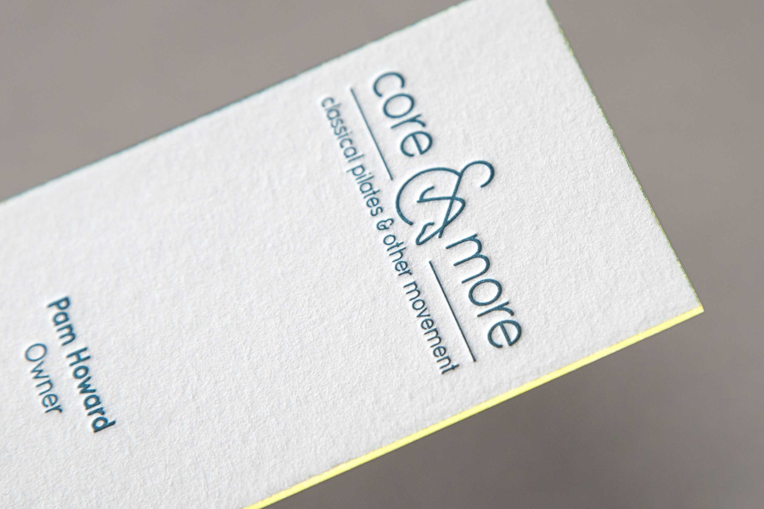 A close up of the Core and More business card to show the edge printing.