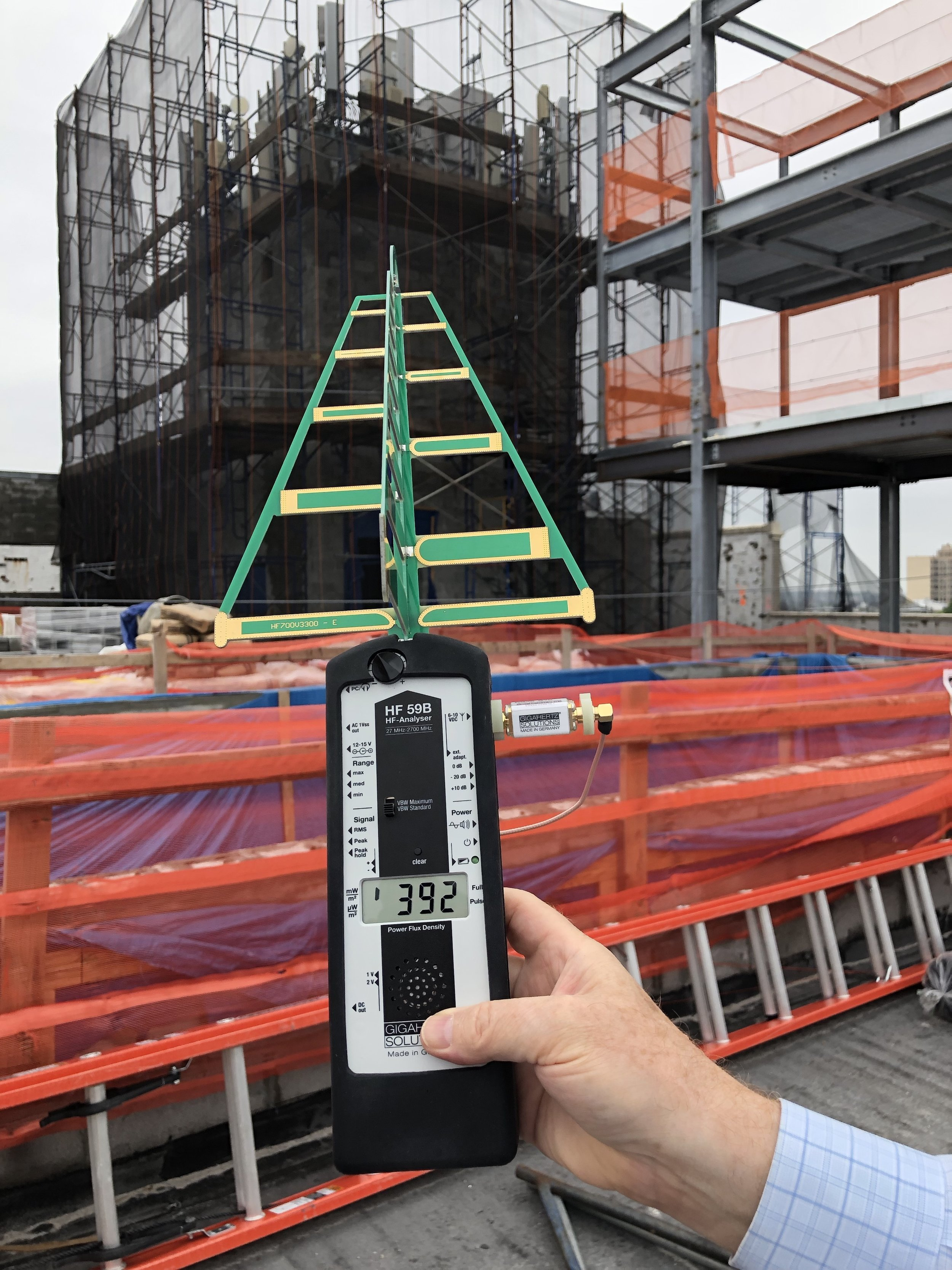 An Industrial RF Survey: measuring a transmitter array overlooking this rooftop construction site near the Grand Army Plaza, Brooklyn, NY. 392 mW/m2 ≈ 392,000 µW/m2 using one of our Gigahertz Solutions HF59B's and a logarithmic periodic antenna.