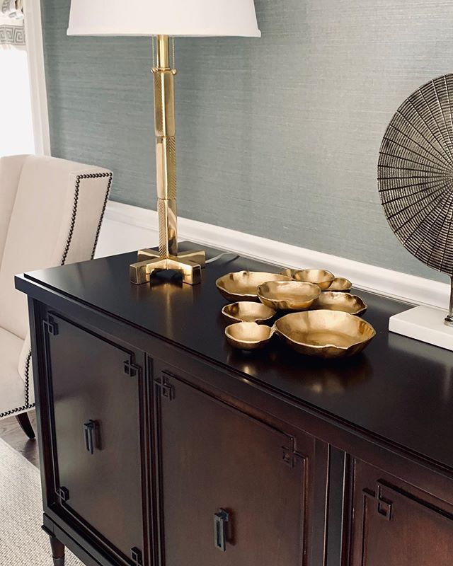 I love everything about this - from the brass detailing on the lamp to the custom designed walnut sideboard - just waiting on the hand hammered brass mirror to be installed - perfection! 💚