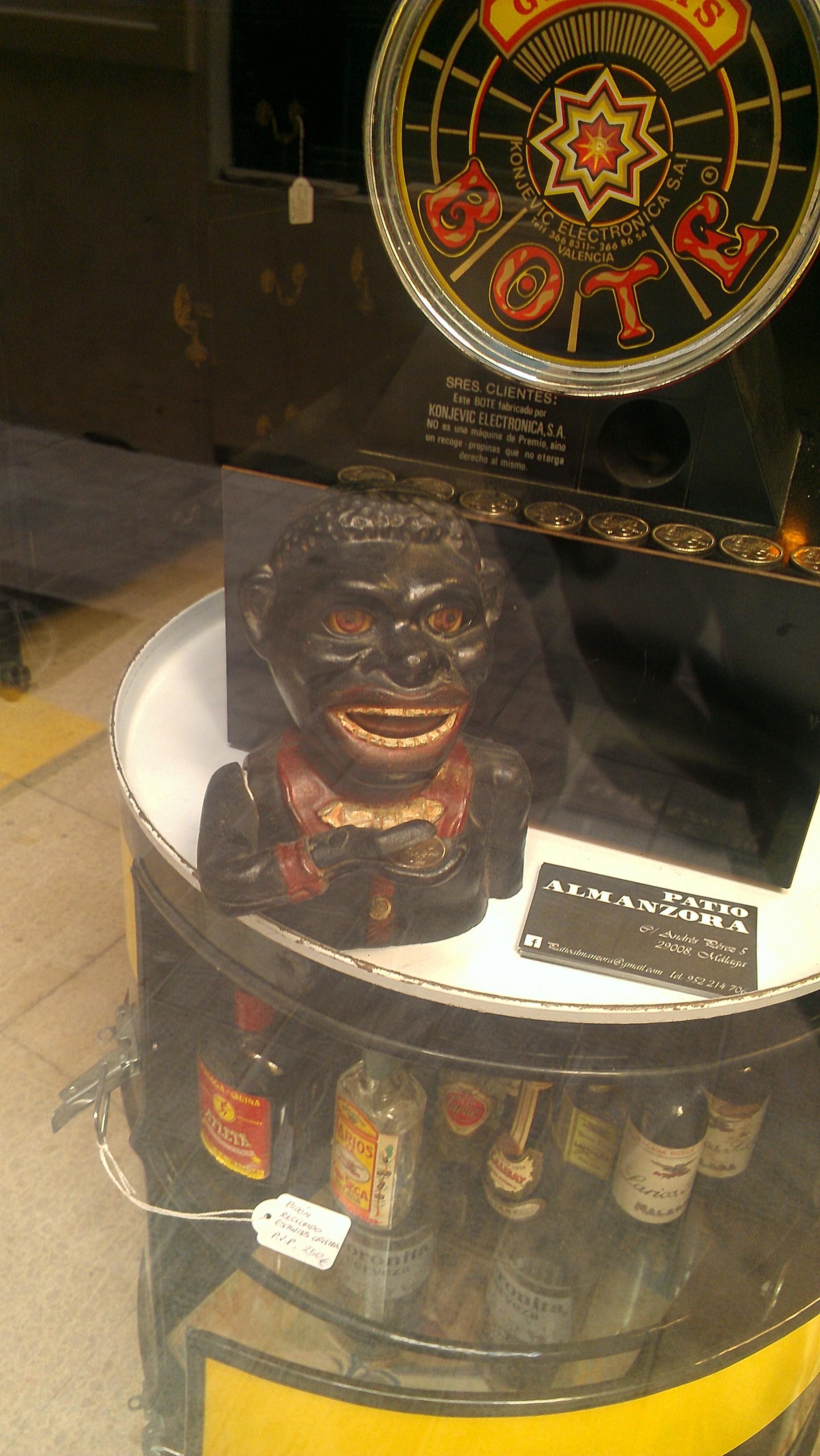 'black sambo' figurine on display in a vintage curiosity shop - Malaga