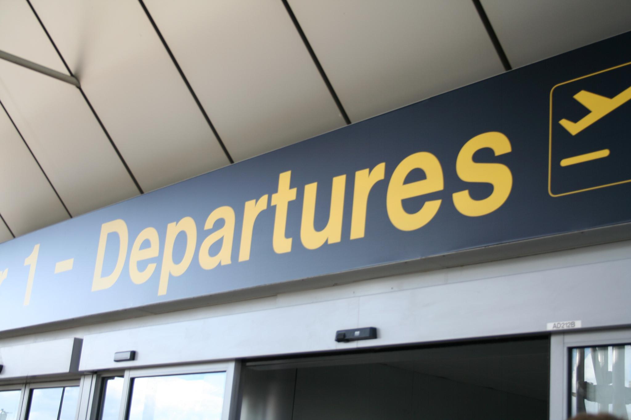 expat-repatriation-blues-departure-sign.jpg
