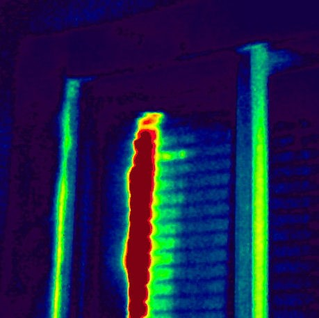 Here is an open curtain with the heat escaping from the window using an infrared camera.