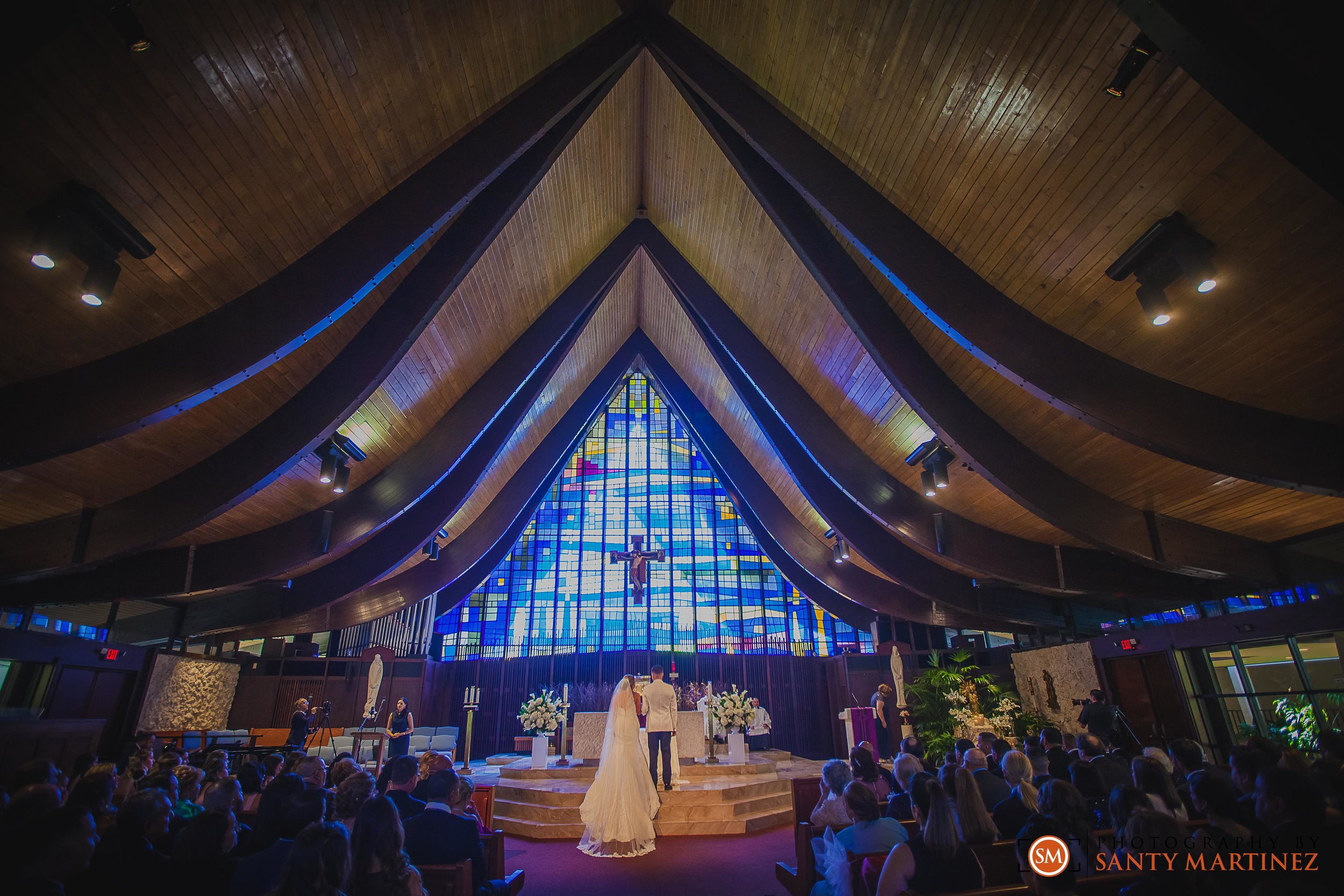 Wedding - St Hugh Catholic Church - Rusty Pelican - Key Biscayne - Photography by Santy Martinez-21.jpg