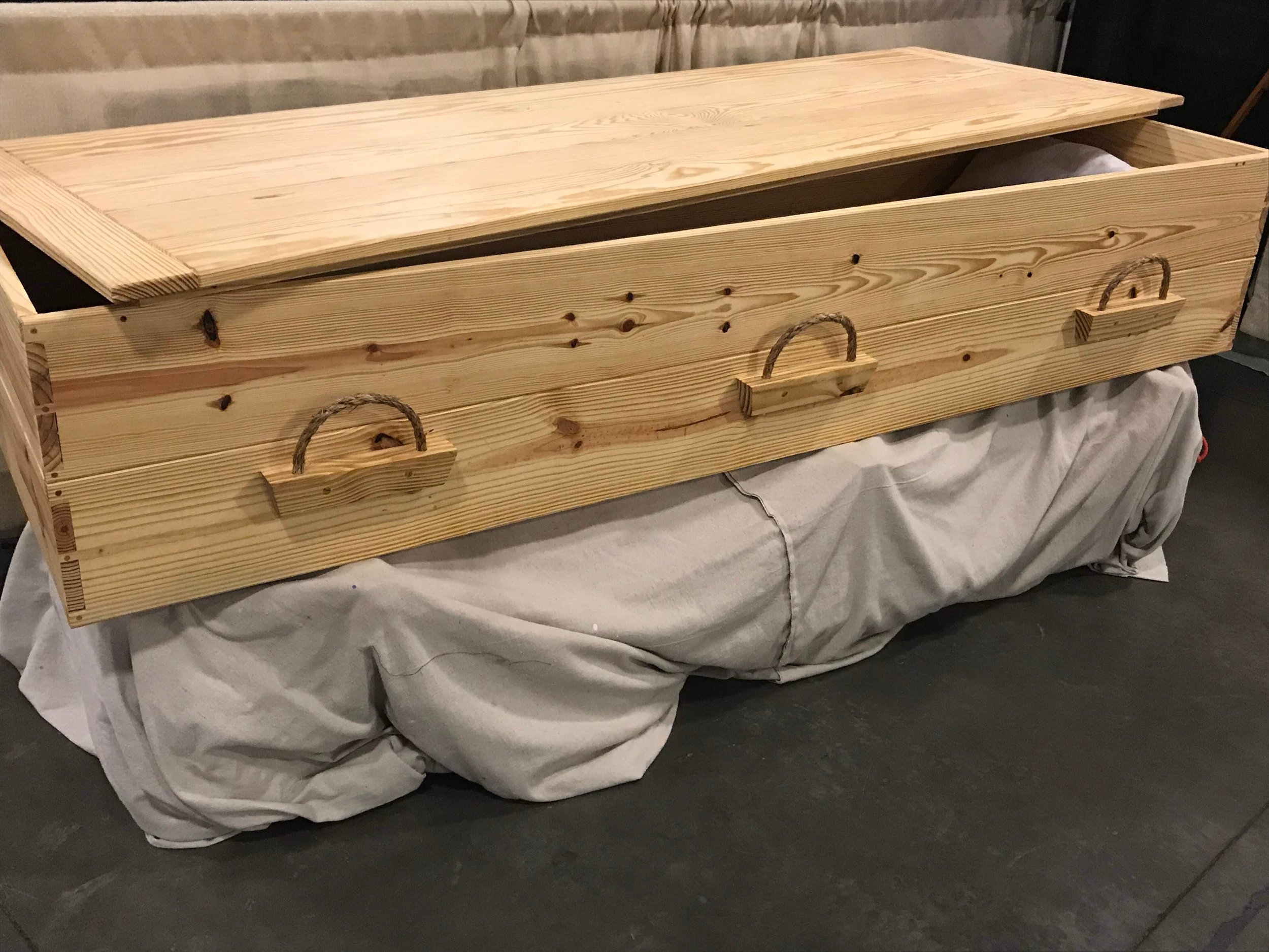 Southern Yellow Pine - no metal | all-wood joinery | sisal rope handles | 3-leaf GBC certifiedEno River model (tung oil finish) | $1800Jordan River model (no finish, kosher) | $1800Just In (Book)Case Casket | Inquire for PriceBuilt by Aldergrove Caskets | More Photos