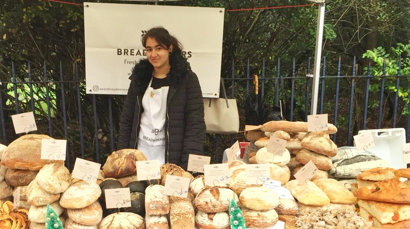 Diwa doing work experience at the Breadwinners stall.