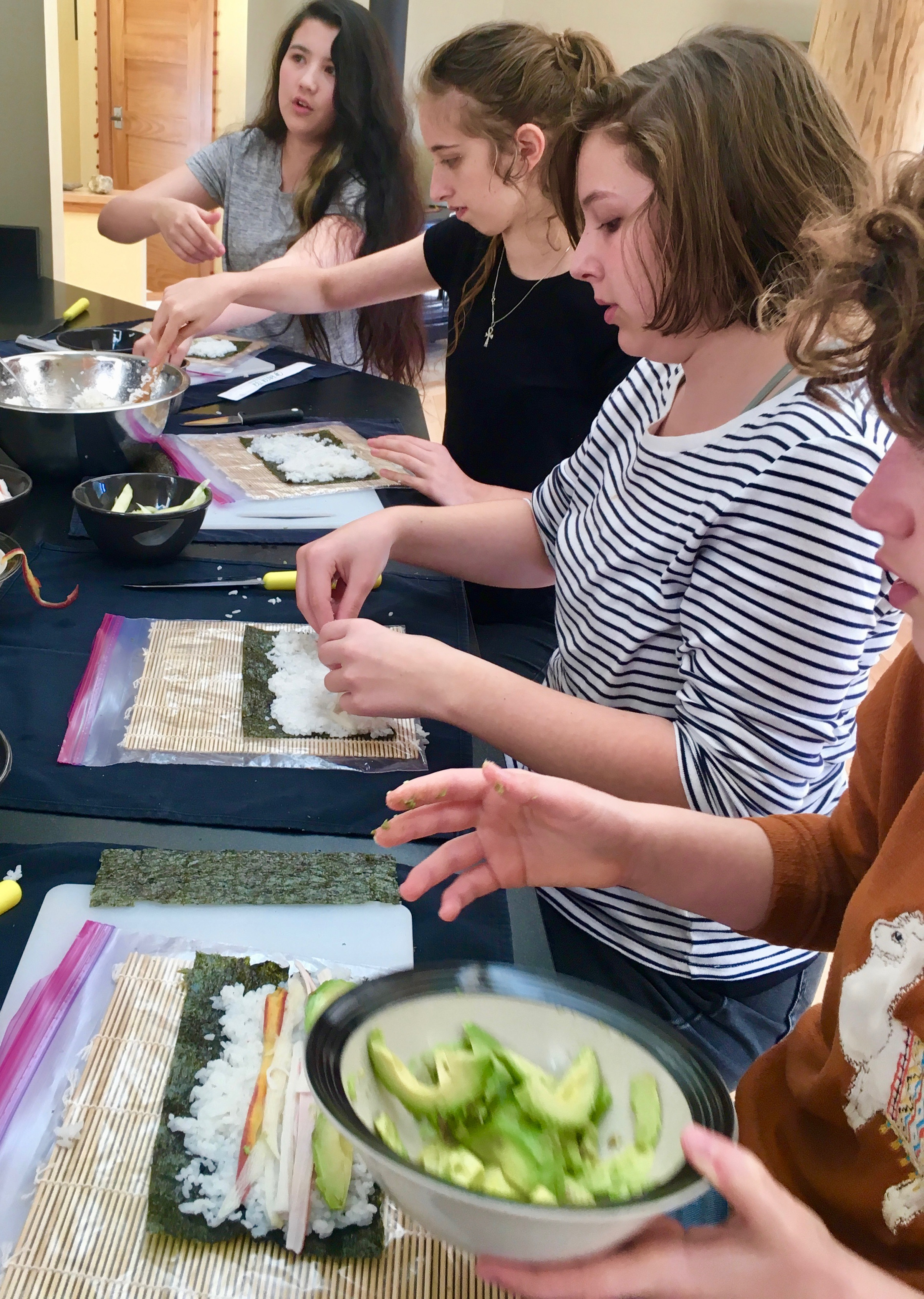 Learning to make sushi in cooking class
