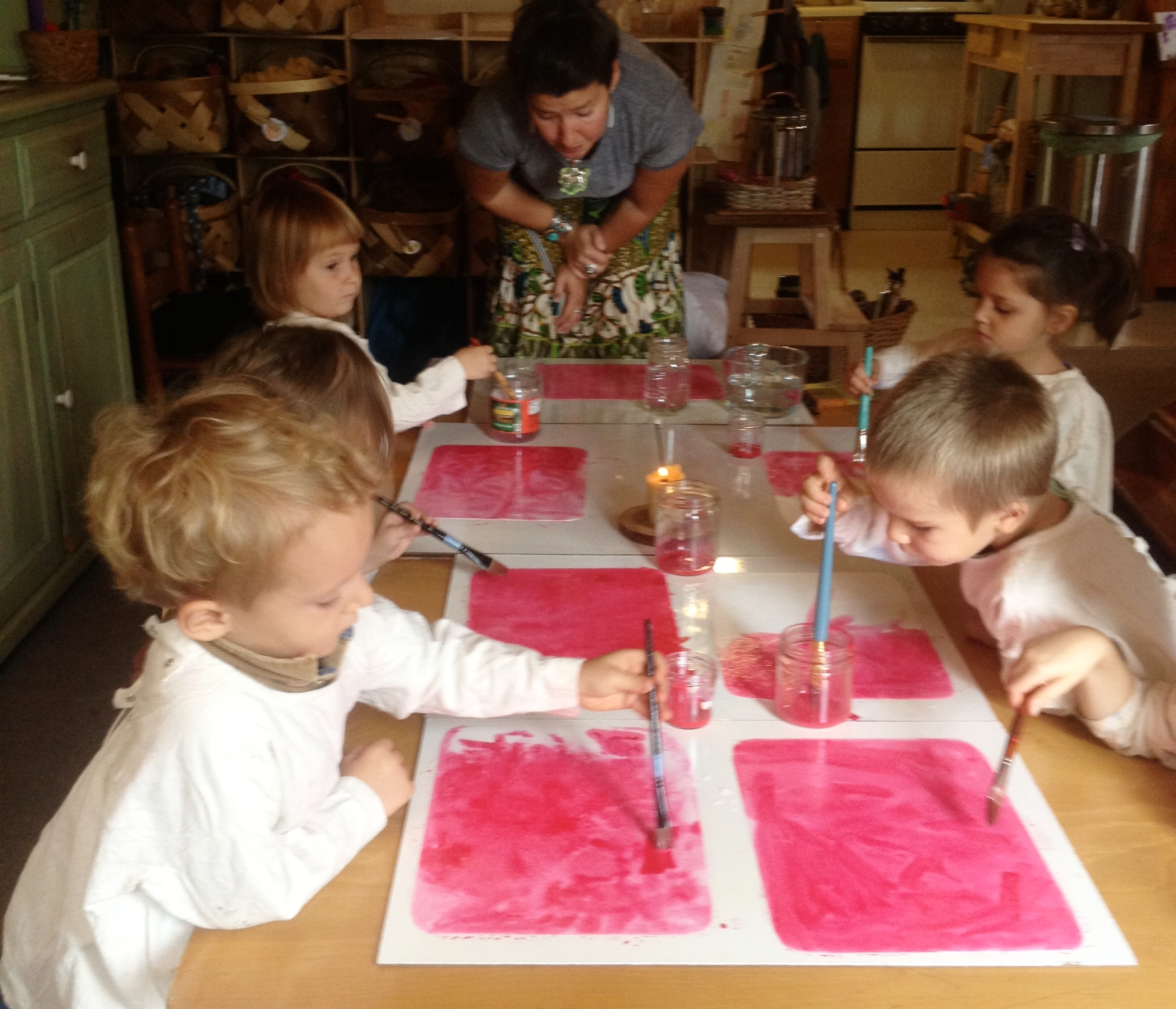 Compassionate guidance during a watercolor activity