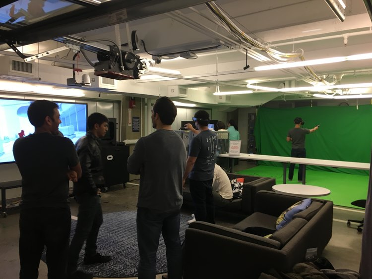 AT A RECENT EVENT, VR CLUB MEMBERS MINGLE WHILE TRYING OUT THE HOLOLENS AND HTC VIVE HEADSETS.