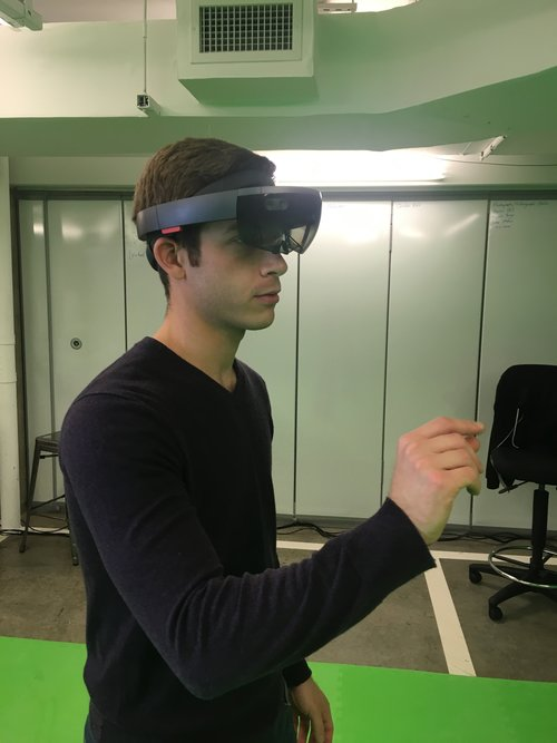 JESSE TEST-DRIVES A MICROSOFT HOLOLENS MIXED REALITY HEADSET AT ONE OF HIS GROUP'S EVENTS.