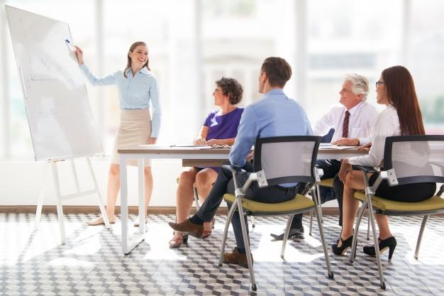meeting-mature-office-showing-presenter_1262-2083.jpg