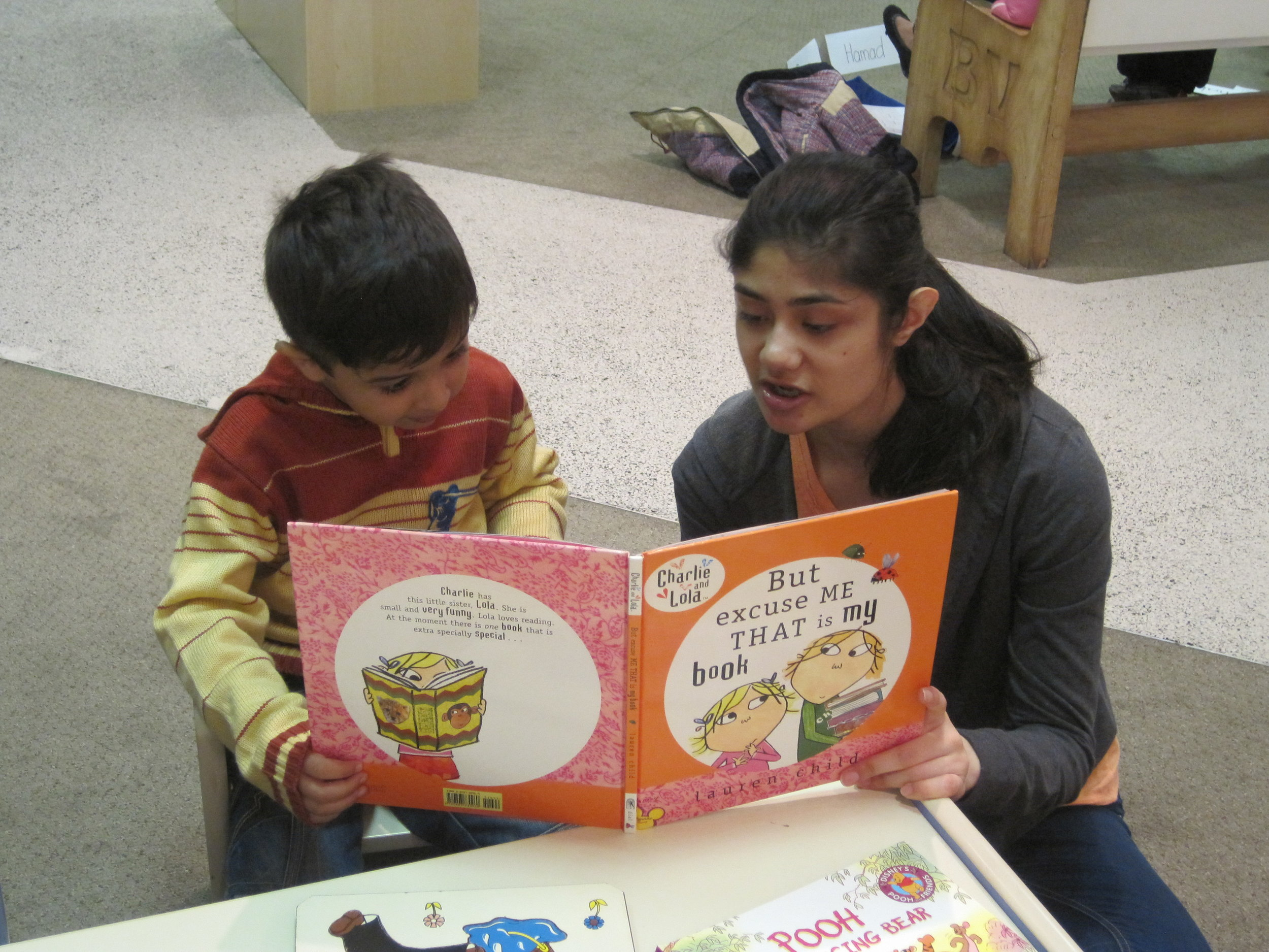 Mohammed just joined us this past Saturday and he has not even begun school yet. That didn't stop him from getting up and telling everyone how much he enjoyed reading about Charlie and Lola with his leader, Faran Gez.