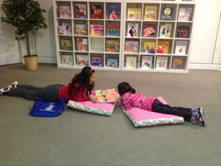 "Hafsa and Saleeha enjoy relaxing with some pillows! Saleeha liked hearing about ""God's Dream"" and both girls read some nursery rhymes together."