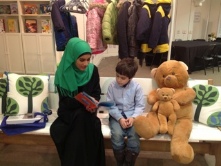 "Sarah and Hadi found a familiar friend at The Story Garden! Here they are reading ""Finding Nemo""."