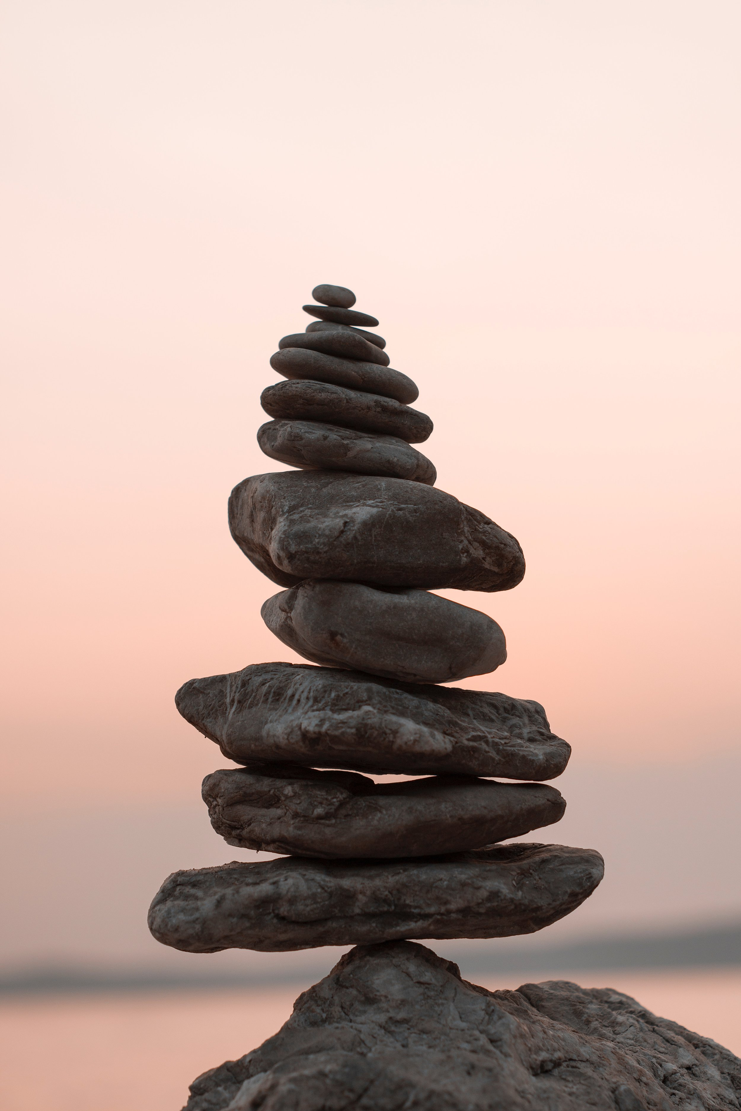 Serious Illness and Caregiver. Meditation Tool. Calming Black Rocks Balancing in a Tower Formation on One Another.