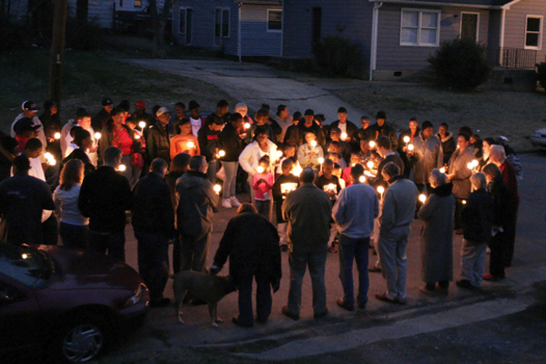 Prayer vigil in East Durham at the site of a homicide victim's death.