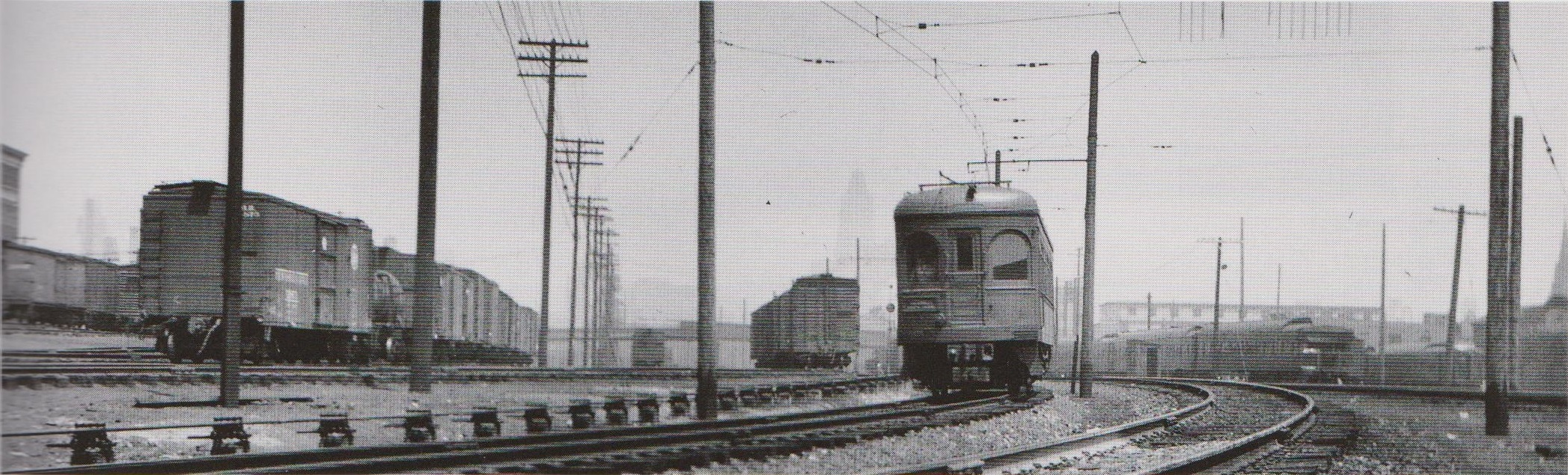 """Baltimore & Annapolis Car leaving Camden Station heading for Annapolis. The view is north from Ostend Street. The Bank of America Building, formerly the Baltimore Trust Company Building, can be seen in the background. Baltimore, Maryland Date: October 1936. Source: J.P. Shuman Photo from """"Baltimore Light Rail, Then & Now"""" by Herbert H. Harwood Jr."""
