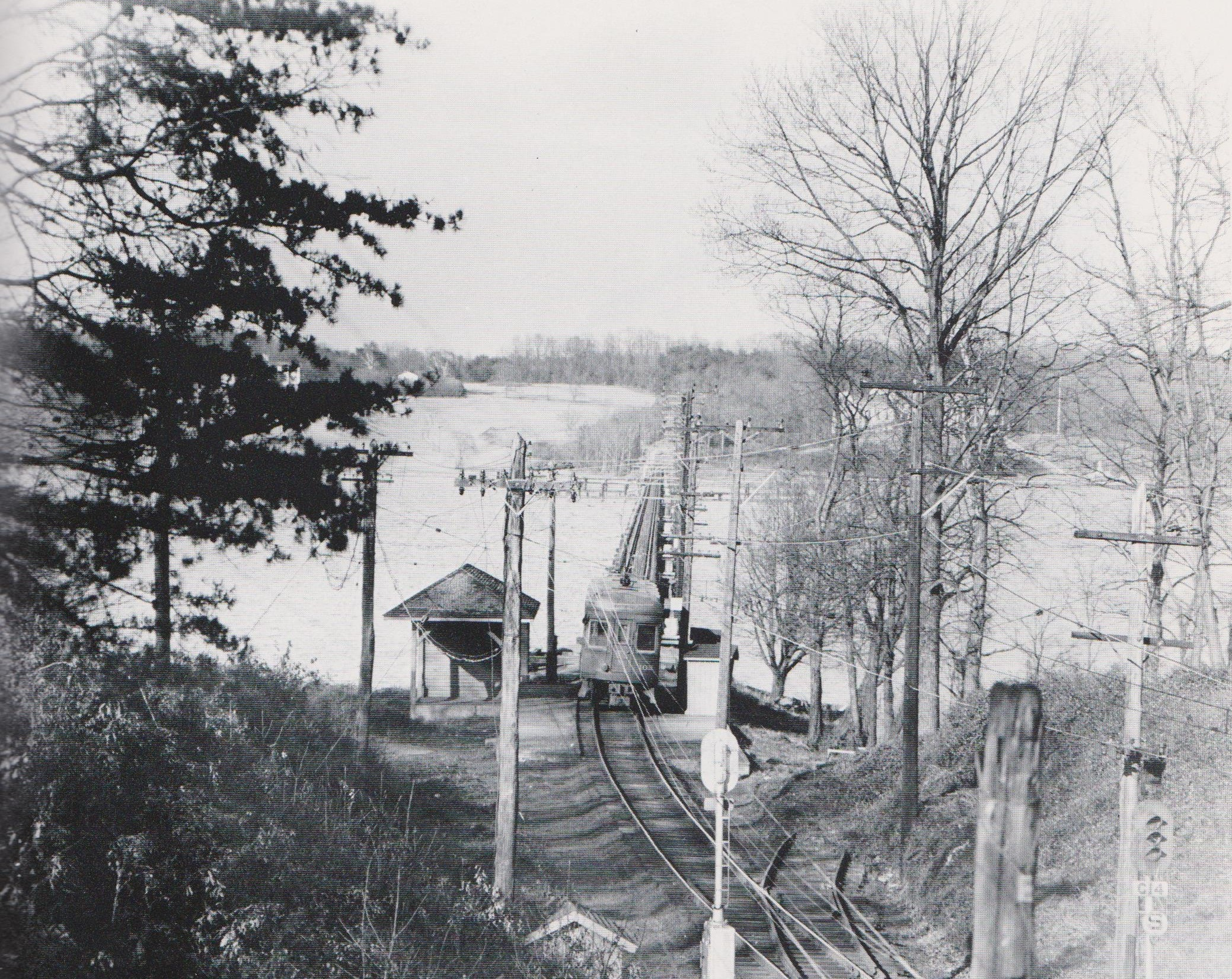 """Wardour Station. """"The plan of block signals included C-14 (foreground) and C-21 (opposite shore) which controlled automatic derails to protect the Severn River Bridge. The view looks toward the north shore."""" Annapolis, Maryland. Date: 1950. Source: R. A. Truax Photograph."""