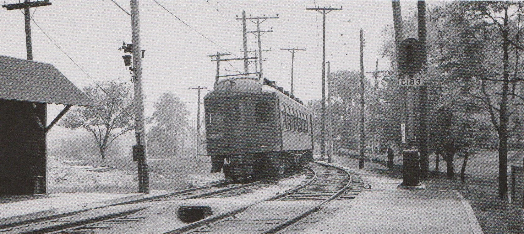 """Baltimore & Annapolis Car #92 approaches Shipley Station heading North. Shipley Station, Maryland Date: May 1936. Source: J.P. Shuman Photo. from """"Baltimore Light Rail, Then & Now"""" by Herbert H. Harwood Jr."""