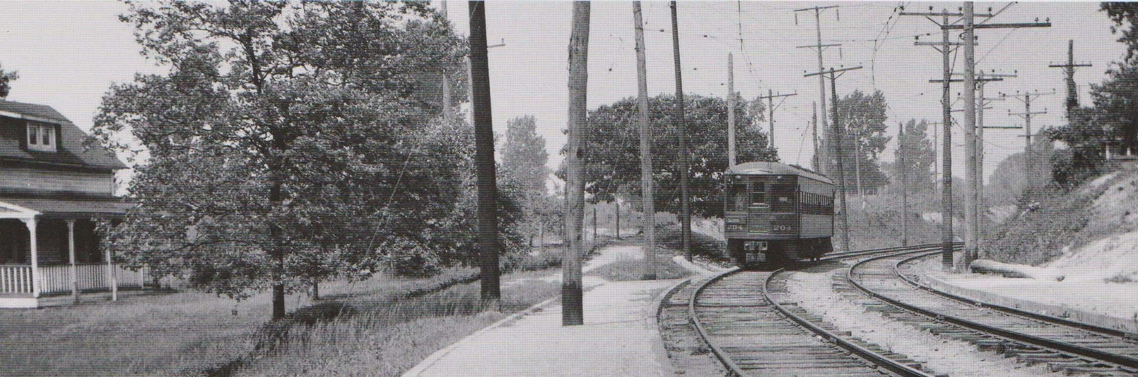 """Top: Baltimore & Annapolis Car #92 approaches Shipley Station heading North. Bottom: Baltimore & Annapolis Car #204 approaches Shipley Station heading South. Shipley Station, Maryland Date: May 1936. Source: J.P. Shuman Photo. from """"Baltimore Light Rail, Then & Now"""" by Herbert H. Harwood Jr."""