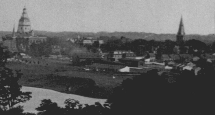 Looking towards Bladen Street Station from the the Government Farm across College Creek. Annapolis, Maryland. Circa 1887. Source: Maryland State Archives.