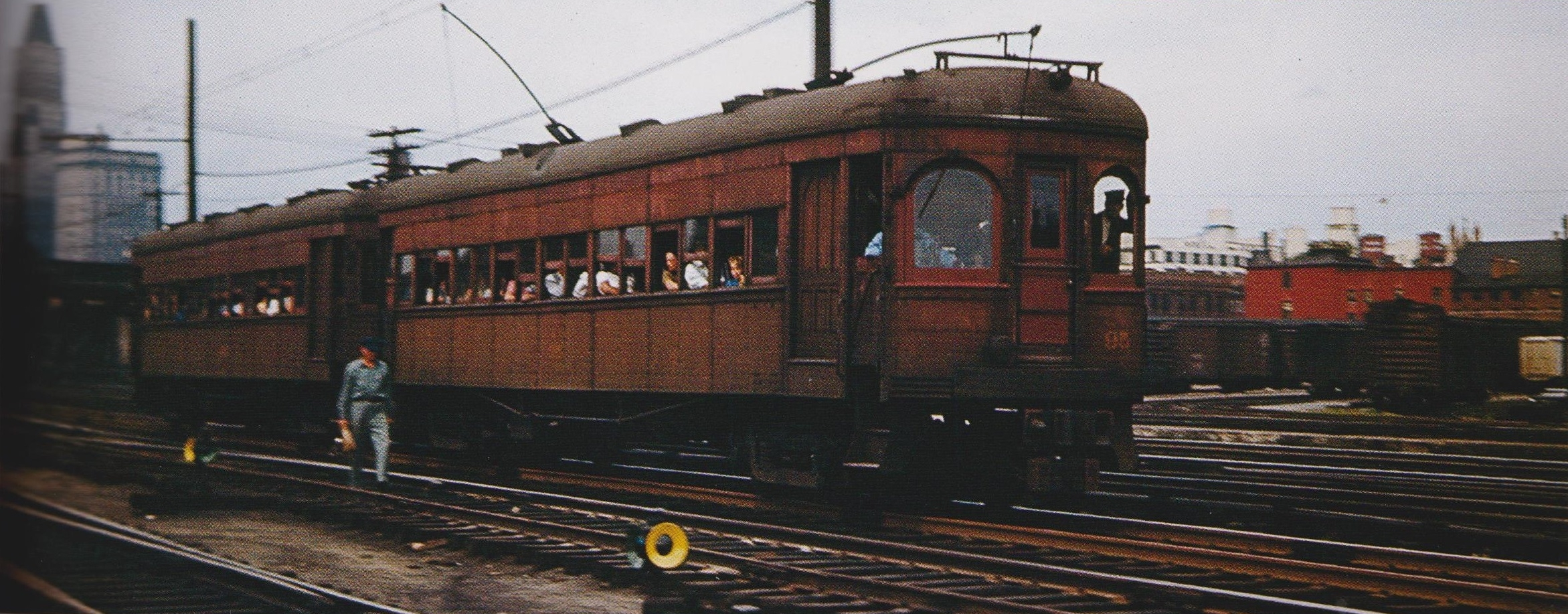 """A two-car Baltimore & Annapolis Train, still on B&O tracks leaving Baltimore's Camden Station for Annapolis. Baltimore, Maryland Date: July 1947. Source: Robert Fillman Collection,""""Baltimore-Washington Trolleys, In Color"""" by LeRoy O. King Jr."""