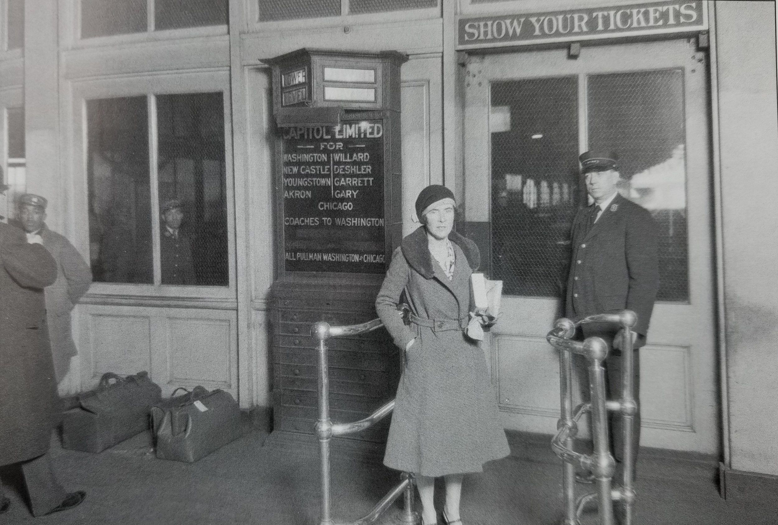 """A passenger waits to board at Camden Station in the 1920's, most likely she will be riding the Baltimore & Ohio's """"Capital Limited"""" which travels from D.C. to Chicago. Date: 1920's. Source: Unknown."""