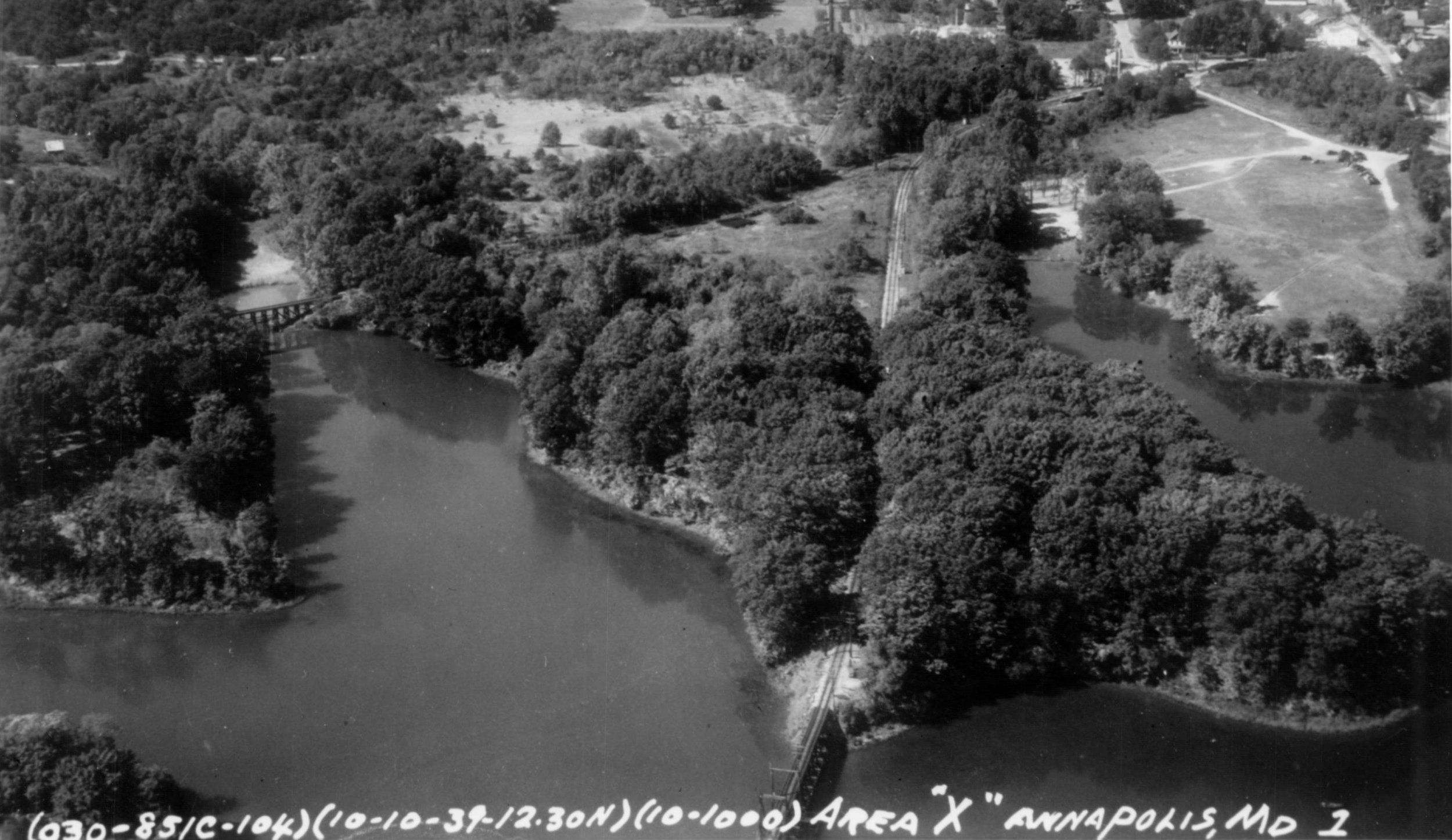 Baltimore & Annapolis Railroad Bridge crossing College Creek can be seen in the bottom of the picture. Annapolis, Maryland Date: October 10, 1939. Source: Maryland State Archives.