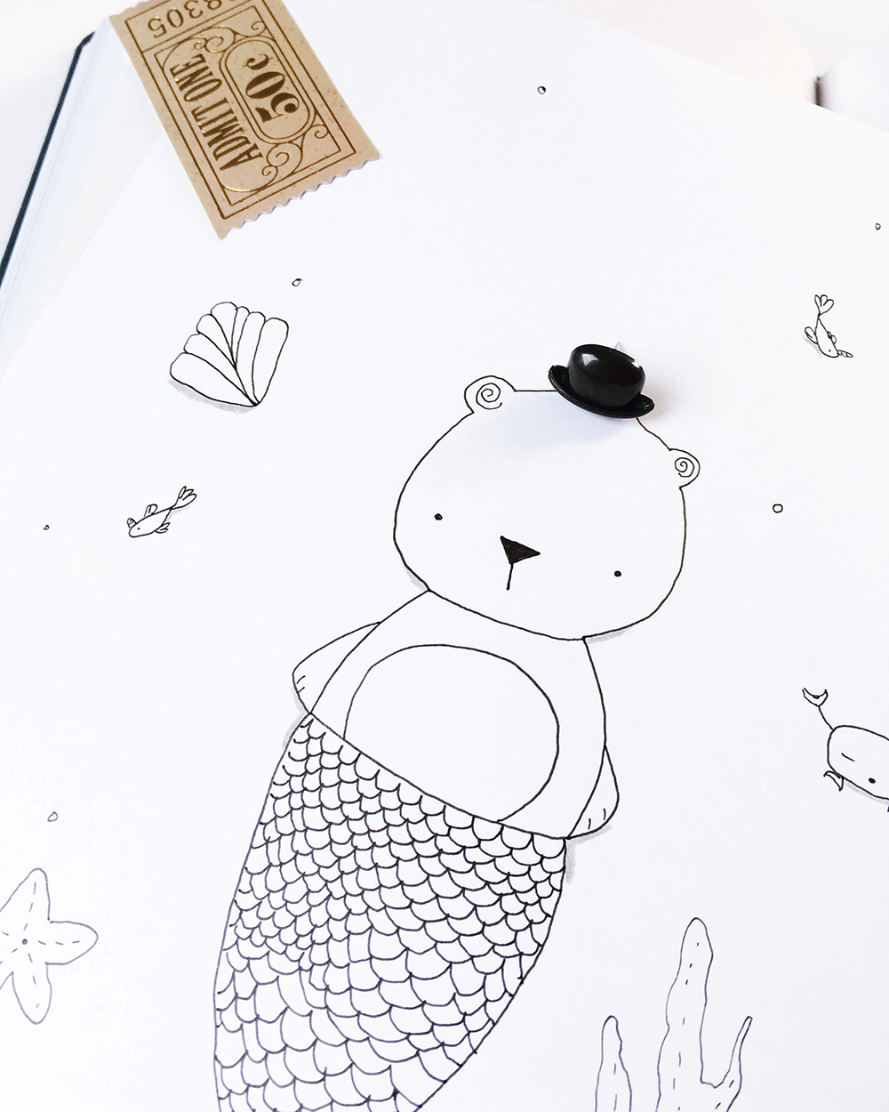 Black and white illustration of a bear in a mermaid costume