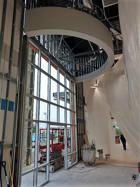 5-3-19 entry vestibule curved soffit, framed and sheet rocked.jpg