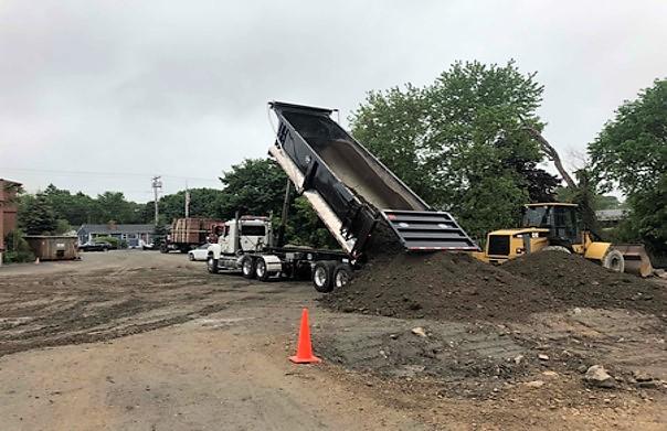 5-30-19 trucking in foundation backfill material.jpg