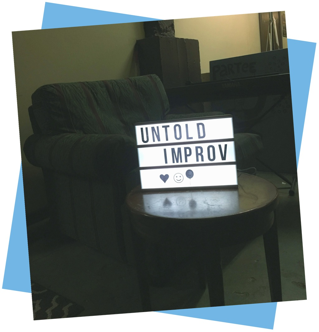 untold-improv-for-people-of-color-san-francisco-sign-heart-balloon-face.jpg