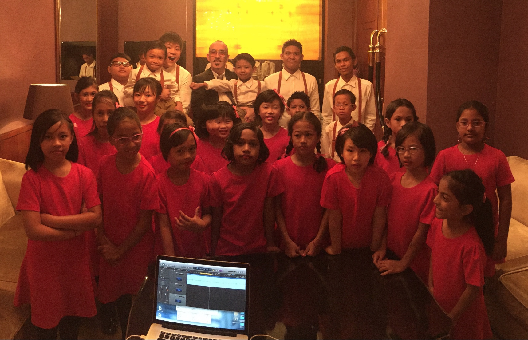 MILK - SLH is pictured here with some of the children from MILK who performed GIVE BACK live alongside cast members from the recording