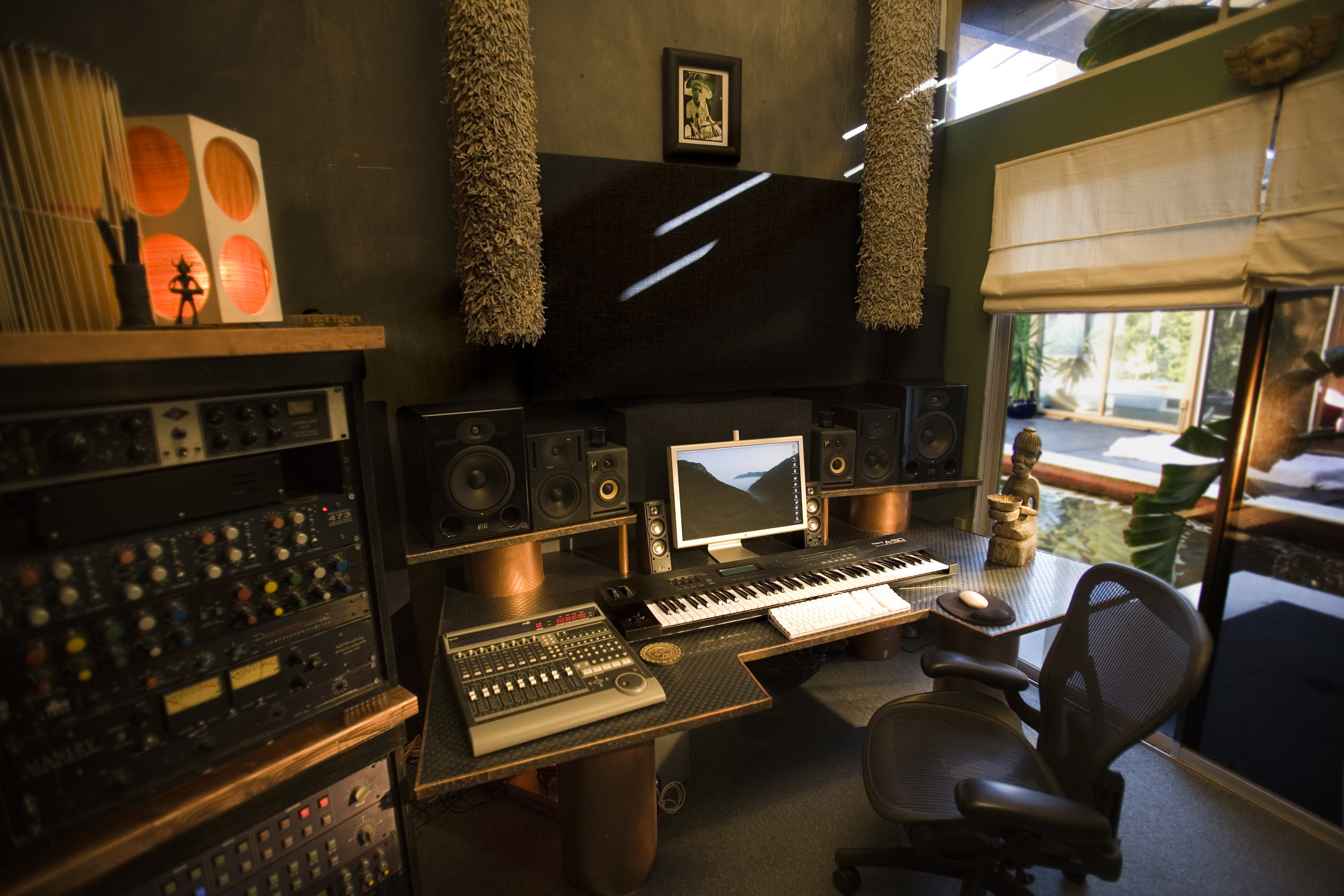 MusicyardMalibu studio1 - Stephen's first studio in Malibu was built in one of the rooms in the house facing the pool, also with an ocean view.For several years he churned out numerous projects from this space. Later he would expand and build Studio 2 in the basement of the house to facilitate recording full band set ups.
