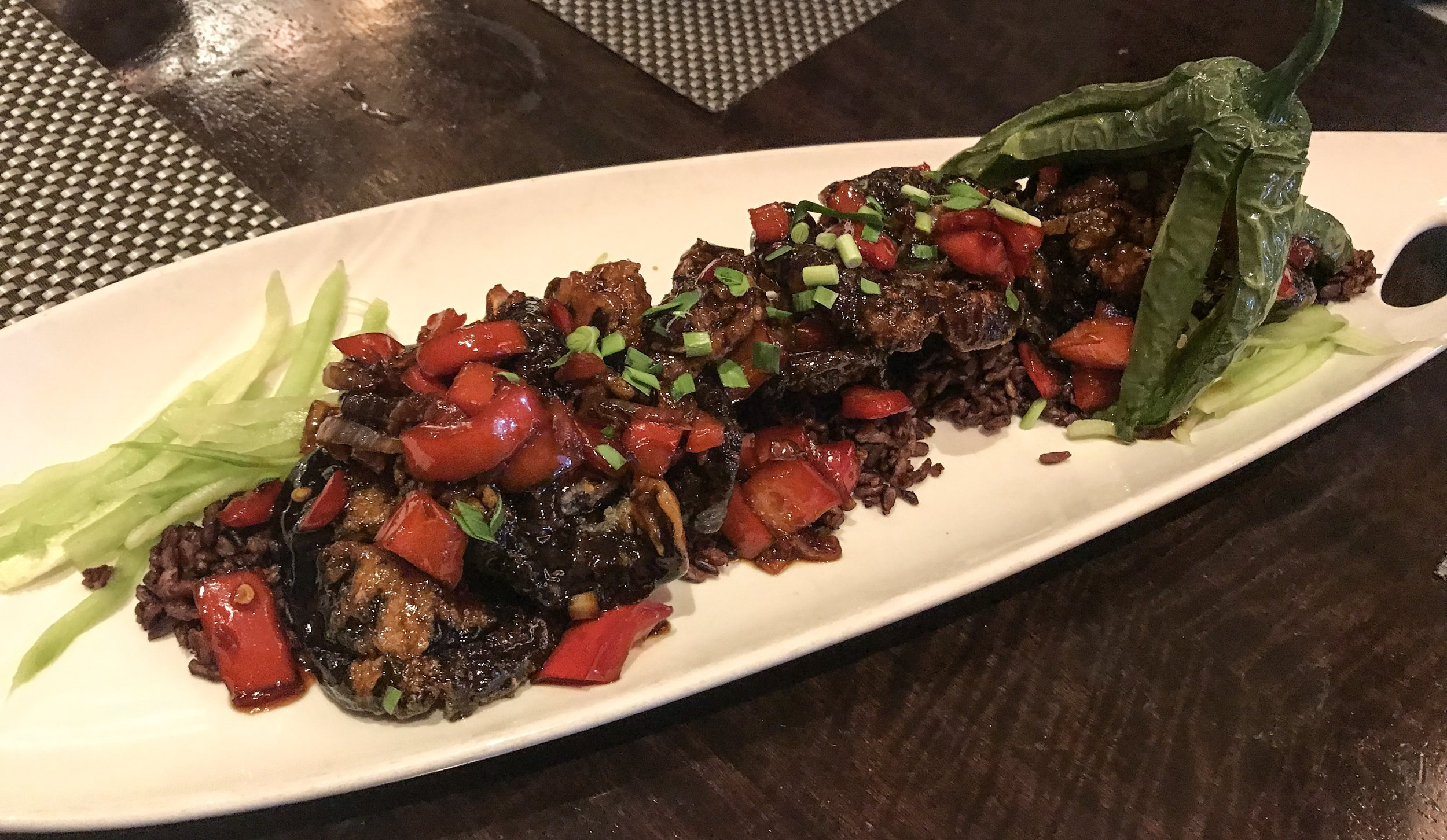 Vegan Calamari - which is actually mushroom wrapped in black rice and had a crispy texture - with red pepper / onion - pretty amazing !!! never had anything like this before. It was exceptional