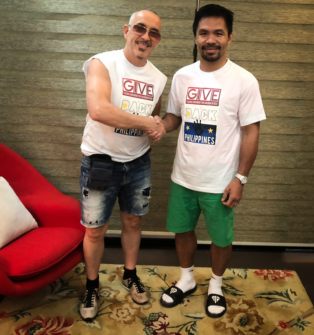 Manny Pacquiao - Stephen seen here pictured with the Senator and World Champion, Manny The Pacman Pacquiao at his home in General Santos Philippines - In 2019 we plan to commence filming and recording the hour long doc on the making of GIVE BACK PHILIPPINES which will feature all the top regional artists performing a unique version of the GIVE BACK song in Tagalo the native language of the Philippines.