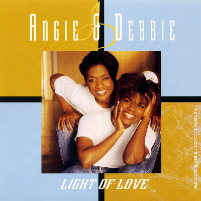 Angie & Debbie Winans - Light of Love featuring Whitney Houston on Background vocals and in the video. SLH produced three singles on their sophomore album for Capitol Records 1993