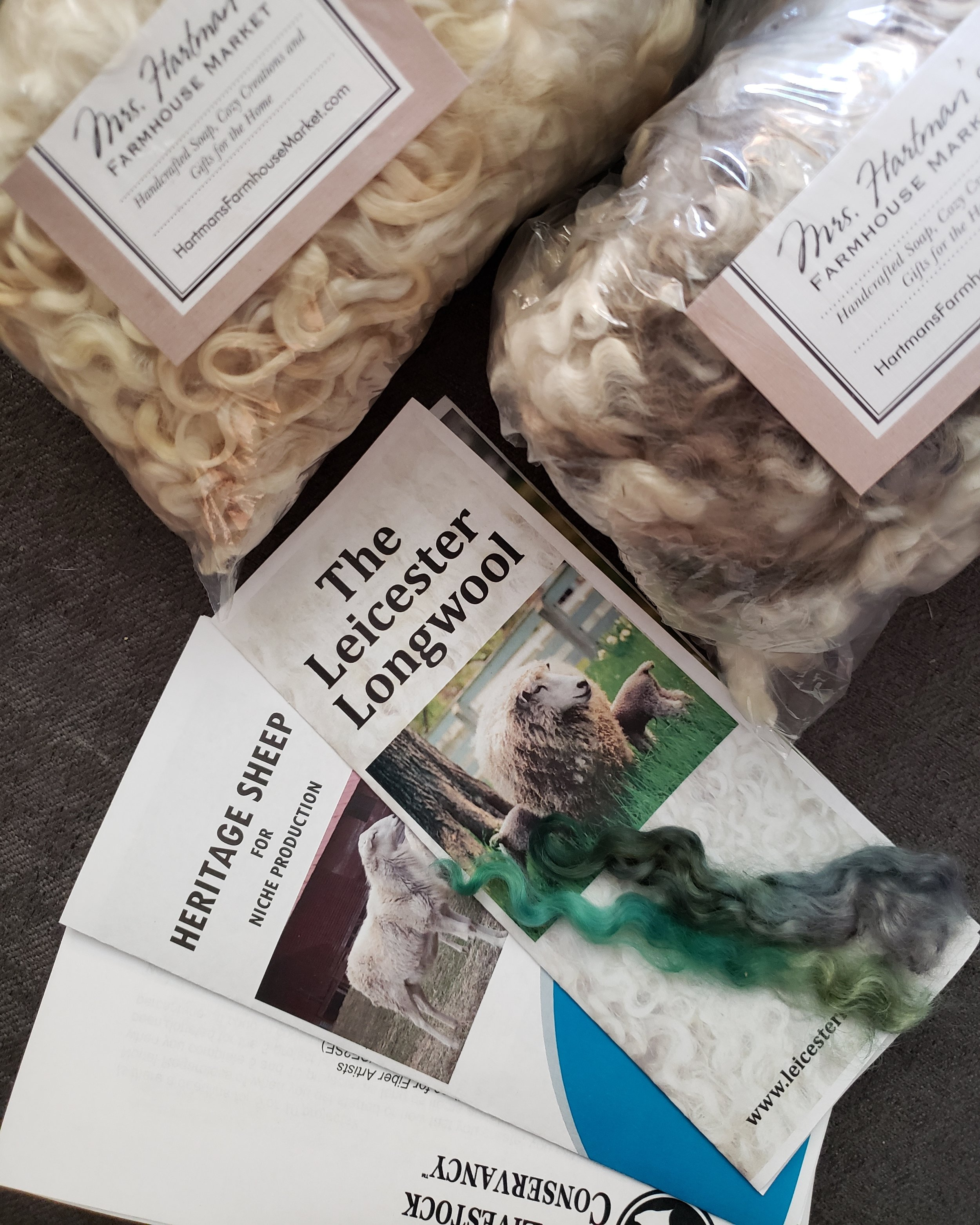 Packages of Leicester Longwool Raw and Washed for Shave 'em to Save 'em customer