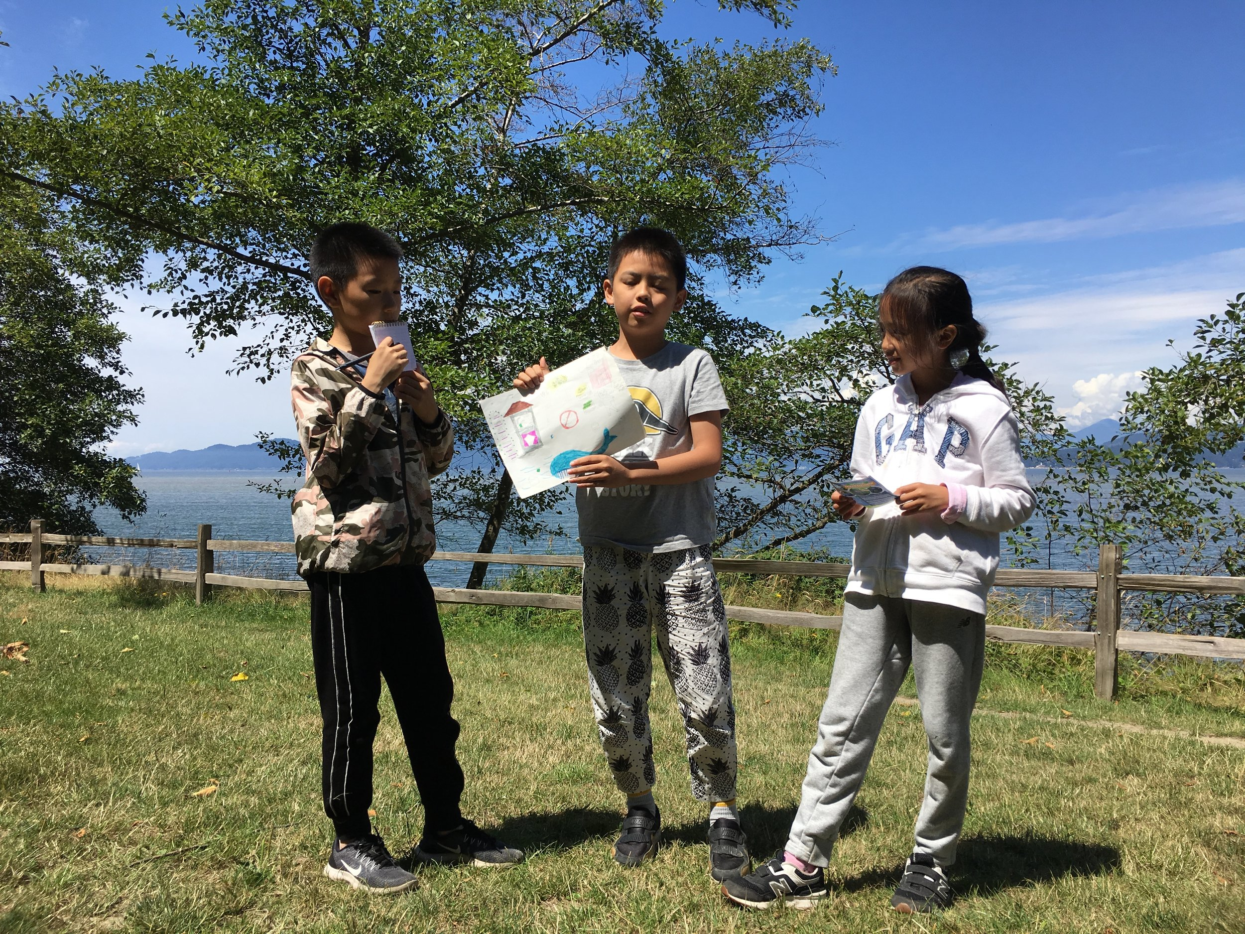 Sea Smart students explaining their Ocean Awareness Project about the need for more shoreline clean ups to protect marine life.