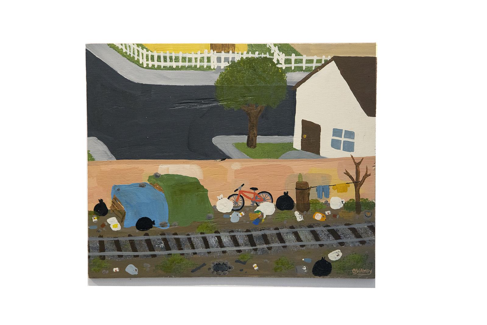 Swampy graffiti artist painting