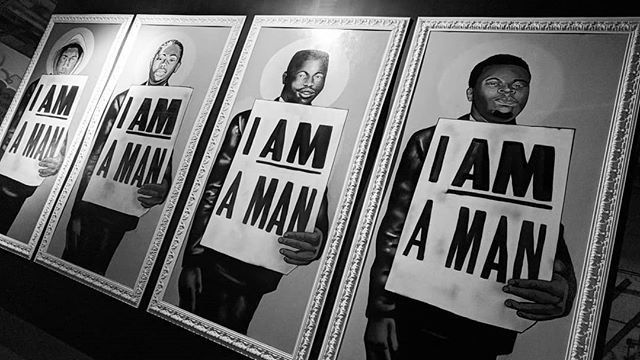 The Ephemeral Eternal solo exhibit by artist/activist Brandan Odumsin New Orleans evokes all the feelings! The history of the 1968 Memphis sanitation strike and the present struggle of police brutality are depicted by paintings of victims like Michael Brown holding I Am a Man signs. Why, after so many years, are people of color still not considered to be human beings, by some? #IAmAMan #bleedingheartdesign