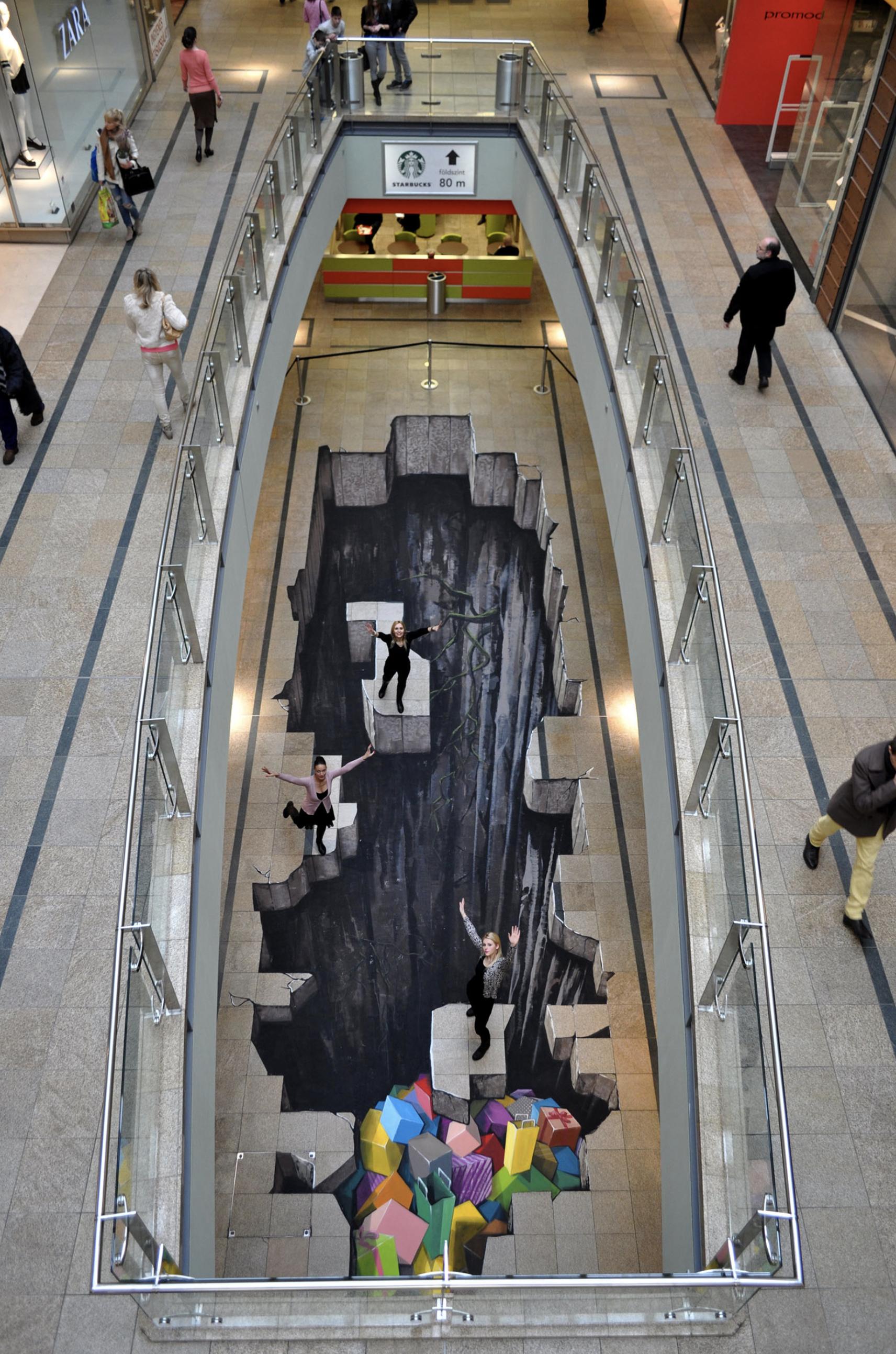 vertigomurals  3D festmények dekorációs földfestés 3D földfestés.png
