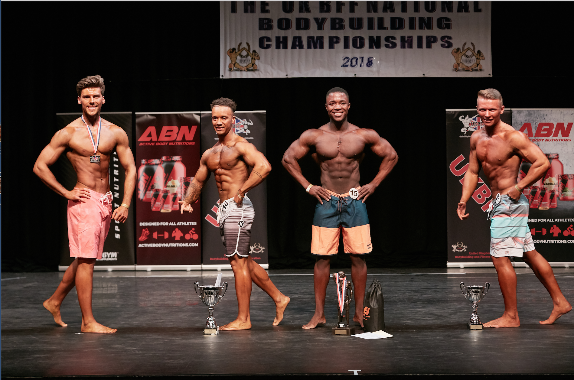 Isaac takes the junior men's physique class at the UK Nationals. Photo by Christopher Bailey.