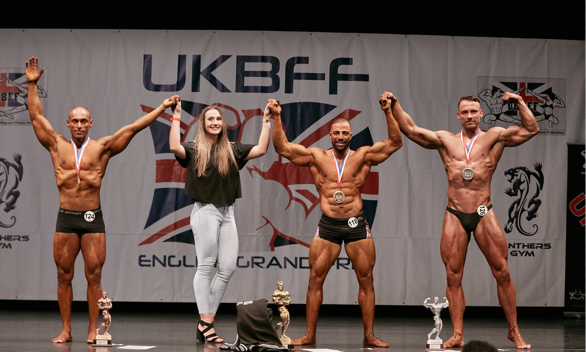 IFBB Elite Pro Connie Slyziut awards the top three places in classic physique to (from left) Miz Rahman, Mahmoud Elmawardy and Michal Uliwiak. PHOTO: by Christopher Bailey