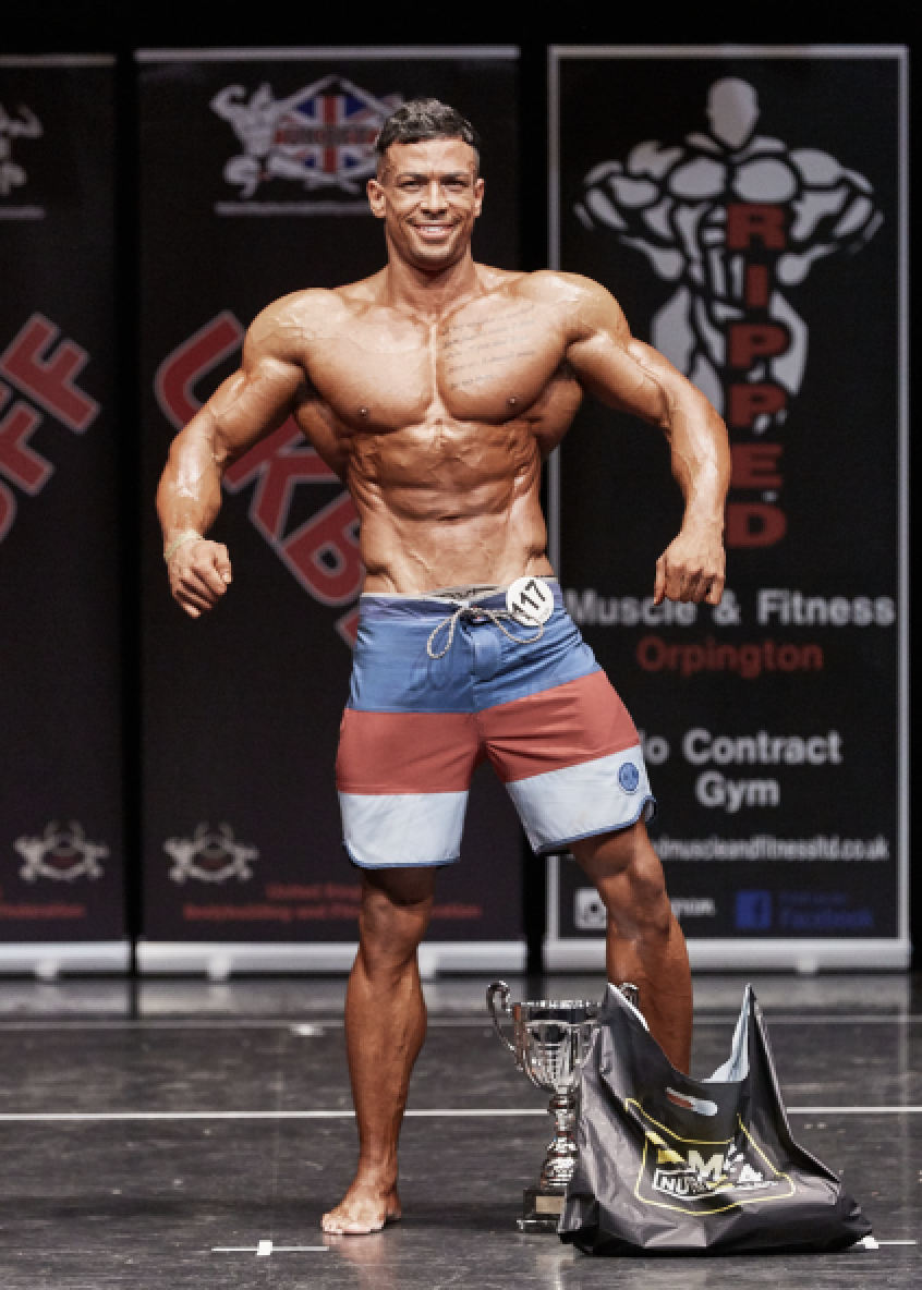 Muscular men's physique champion Aaron Clarke by Christopher Bailey.