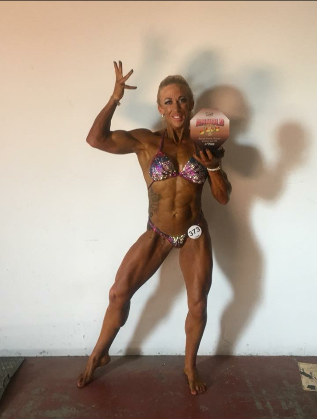 Claire Johnson celebrates her top six finish in women's physique.