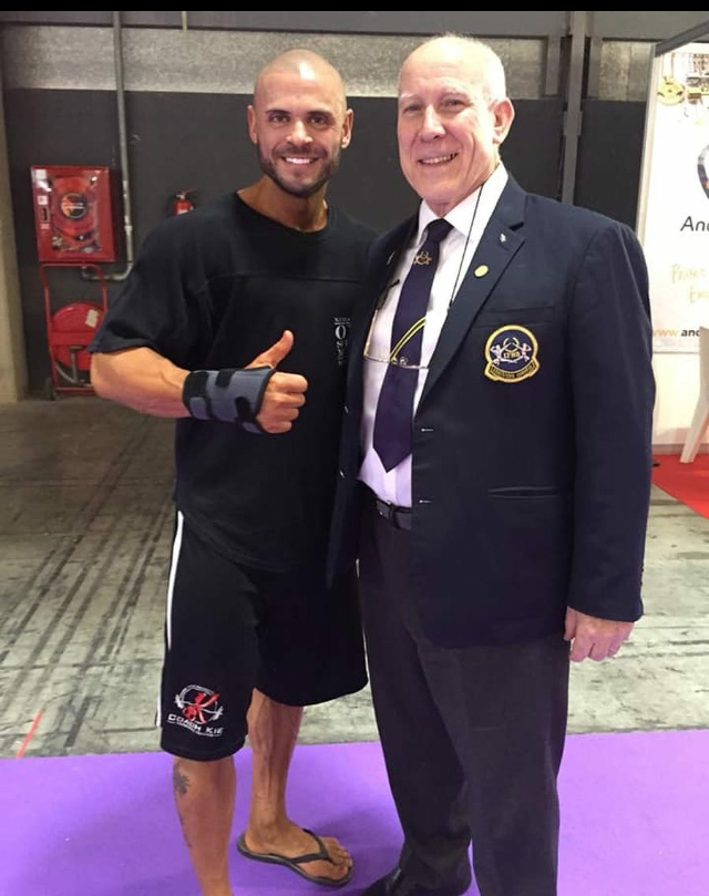 Kie West, who overcame a broken wrist to finish in the top 10 in classic bodybuilding, with UKBFF president Bill Tierney.