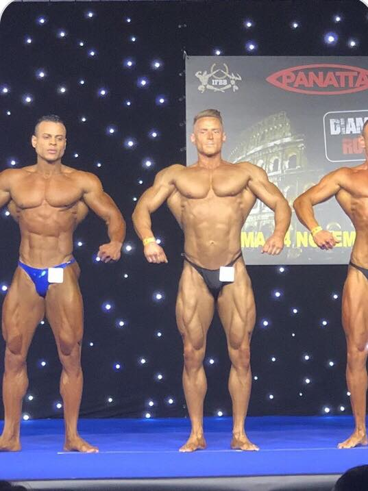 Louis Moylan (black trunks) looking superb in classic bodybuilding.
